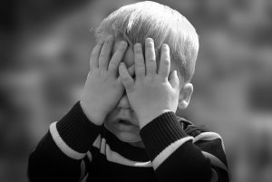 Child hiding face : Lavorocare ASD SUpport Workers : Image CC0 Pixabay